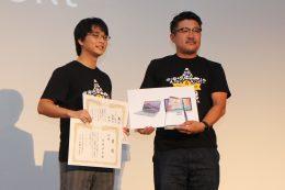 優勝した西村佳之さん(左)